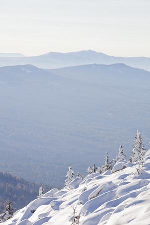 snowdrifts: Mountain range Zyuratkul, winter landscape. Snow covered spruces and snowdrifts Stock Photo