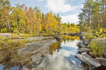 Lake in forest. Karelian autumn Landscape, Russia.
