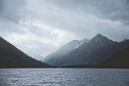 Menacing sky over the Multinskoe lake. Altai landscape.