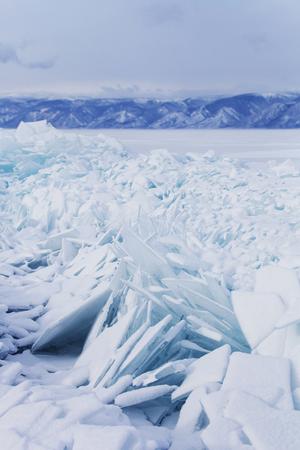 hummock: Turquoise ice floes. Winter landscape. Baikal lake hummock