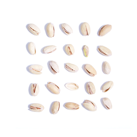 Collection of dry salty pistachios on white background. Food set