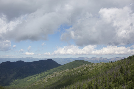 lows: Green hills mountains landscape. Blue sky with clouds. Altai republic summer nature; Russia