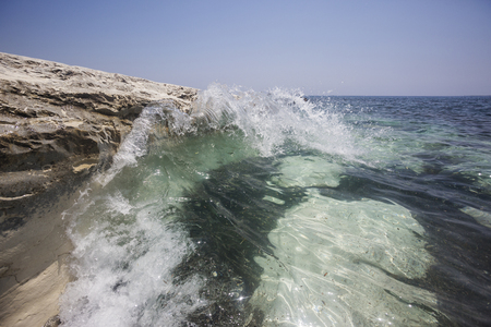 Mediterranean sea landscape. Wave and white rock near Governors beach, Cyprus