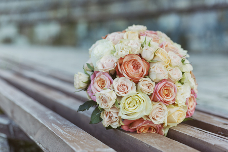 Wedding. Bridal bouquet of rose flowers on wooden background