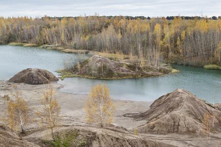 pit fall: Turquoise quarry at Romantsevo (village Konduki). Tula region; Russia. Extraction of coal. Autumn landscape