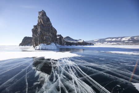 Cracks in ice of Lake Baikal, Oltrek island. Winter landscape