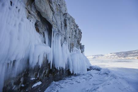 Icicles in Ogoi island rock. Lake Baikal. Winter landscape