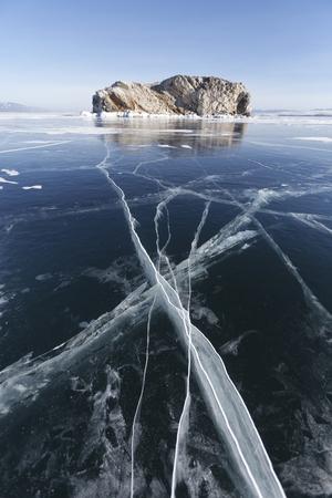 Cracks in ice of Lake Baikal, Borga-Dagan island. Winter landscape Stock Photo