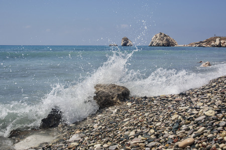 A wave on the beach near the Aphrodite stone. Cyprus. Turquoise water of the Mediterranean Sea