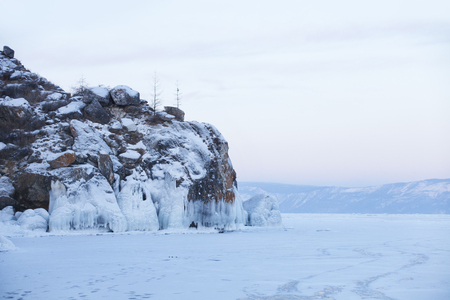 Icicles in Olkhon island rock. Lake Baikal. Winter landscape
