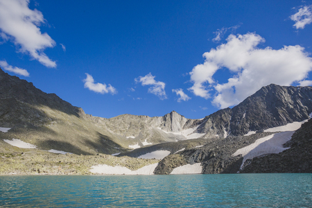 Turquoise water of Upper Akchan lake. Mountain Altai landscape