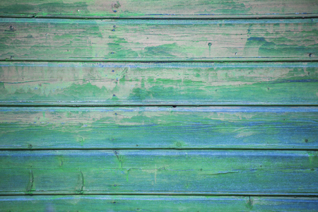 Old wood planking background with green paint, grunge texture Imagens