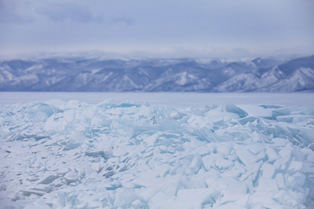 Turquoise ice floes. Winter landscape. Baikal lake hummock