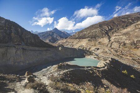 Gangapurna lake with turquoise water in Himalaya mountains in Nepal