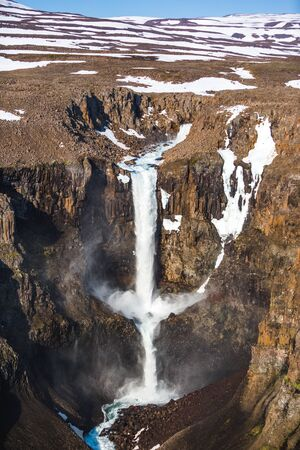 55-meter two-stage waterfall on the first right tributary of the Hikikal river, Putorana Plateau, Taimyr. Russia, Siberia Banco de Imagens