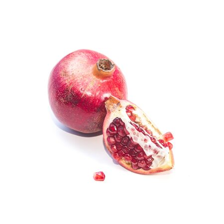 Ripe pomegranate fruit isolated on white background