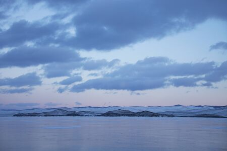 Winter sunset landscape. Small sea of Lake Baikal