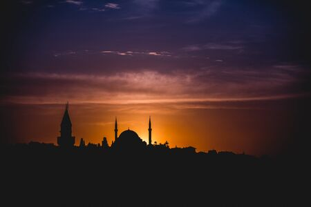 Silhouette of the Turkish city of Istanbul with mosques at sunset Stock Photo