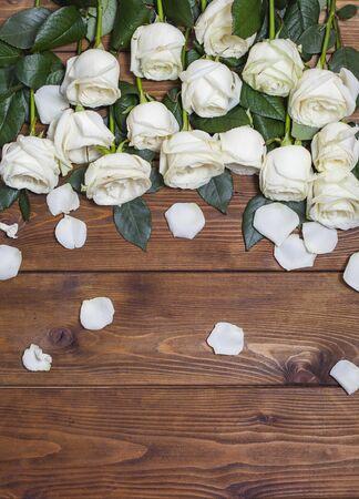 White fresh rose flowers on wooden background Stock Photo