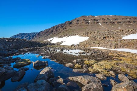 Small lake on Putorana Plateau, Taimyr. Russia, Krasnoyarsk region