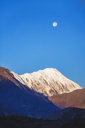 Silhouette of the Himalayan mountains on blue sky. Nepal
