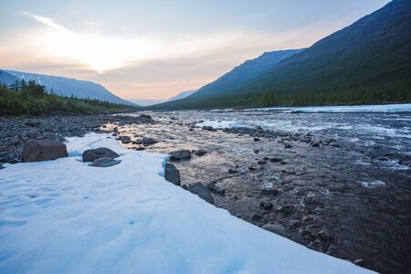 Snow and ice on the banks of the river Hoisey. Polar day on Putorana Plateau, Taimyr 写真素材