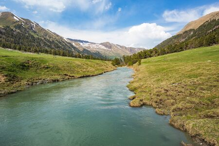 Marfa River with turquoise transparent water. Caucasus Mountains spring landscape. Karachay-Cherkessia republic, Russia