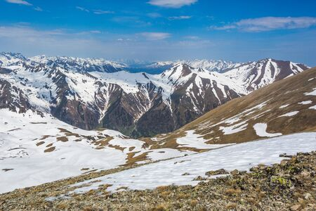 Snow-capped peaks of the Caucasus Mountains landscape. View from the Muhu Pass, Karachay-Cherkessia, Russia