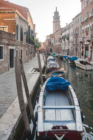 Boats on the water in one of the canals of Venice. Italy