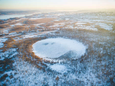 Bottomless circle Lake in forest of Solnechnogorsk District, Moscow region. Russia. Aerial winter view