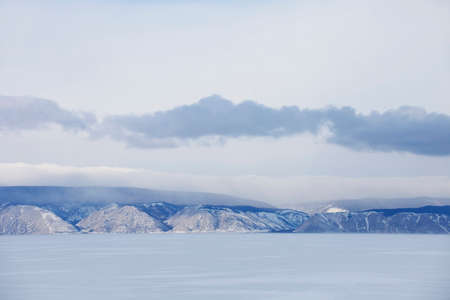 Baikal lake winter landscape. Snowy mountain peaks
