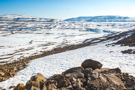 Rocks and snow on the Putorana Plateau. Taimyr. Russia, Krasnoyarsk region