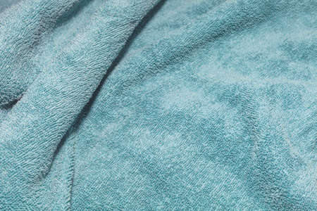 Texture of a turquoise bath towel fabric background