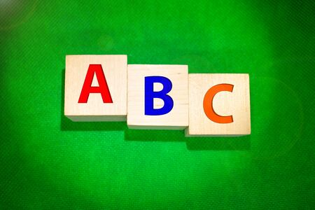 ABC blocks in front of a green chalkboard with copy space 版權商用圖片