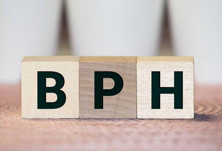 BPH Benign Prostatic Hyperplasia acronym on wooden background Foto de archivo