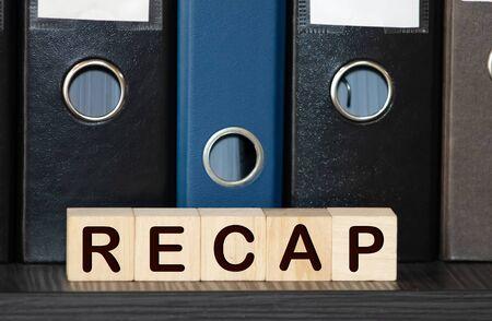 Recap word from wooden blocks on desk