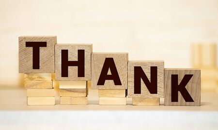 Cubes each with a letter on it written the word thank you Stock Photo