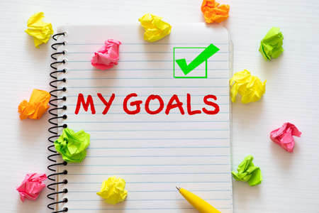 My goals list with empty checkboxes on a corkboard