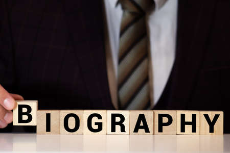 Biography word written on wood block