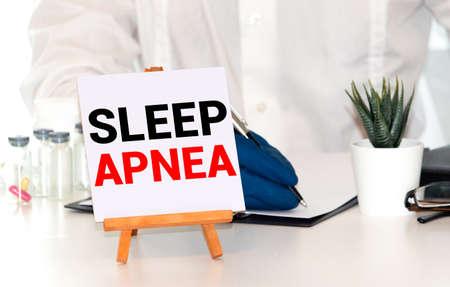 Stethoscope on wood with Sleep Apnea words as medical concept