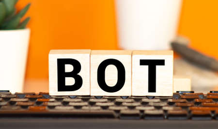 Colorful alphabet blocks spelling the word BOT