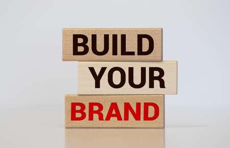 Build your Brand written on wooden blocks with vintage styled background. Branding rebranding marketing concept. 版權商用圖片