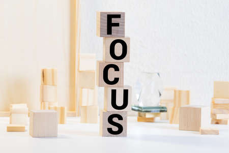 focus word on wood blocks, business concept