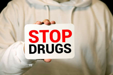 Stop Drugs words on Brick Wall Addiction awareness, Say No to Substances Abuse concept. Motivational call written on the wall