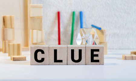 word clue on white toy cubes, business concept