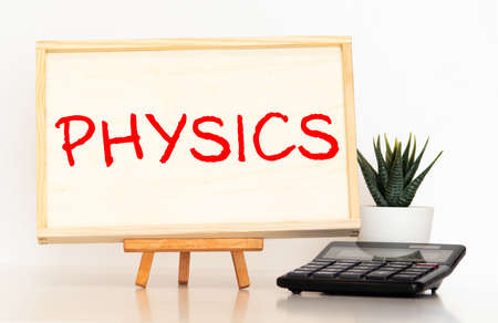 PHYSICS word written on wood block, concept
