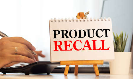 product recall text write on paper, business concept