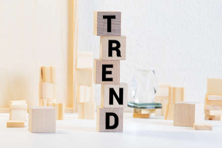 Wooden blocks with the word Trends. Popular and relevant topics. New ideological trends.