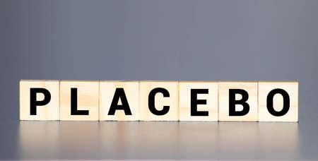 Placebo word written on blocks. Placebo effect, fake medical treatment.