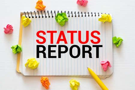 Word writing text Status Report. Business concept for Update Summary of situations as of a period of time Male human wear formal work suit presenting presentation using smart device.